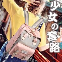 甜甜圈双肩包女韩版帆布初中高中小学生书包原宿