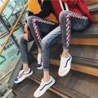 新款2018秋冬季男女修身小脚牛仔裤韩版个性条纹撞色潮流情侣裤子