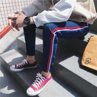 新款帅中性小码潮男裤子韩版潮流S码男生牛仔裤小脚裤