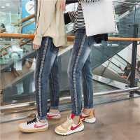 新款情侣牛仔裤秋冬季休闲裤青年个性织带长裤女韩版修身小脚裤子