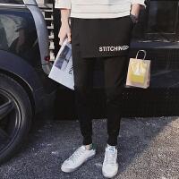 新款中学生个性韩版潮流假两件裙裤休闲裤男小脚束腿哈伦裤发型师