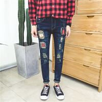 新款青少年学生个性韩版潮流刺绣贴标破洞另类牛仔裤男涂鸦小脚裤